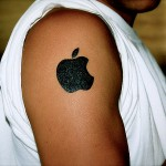 Apple logo tattoo on an Apple fans shoulder